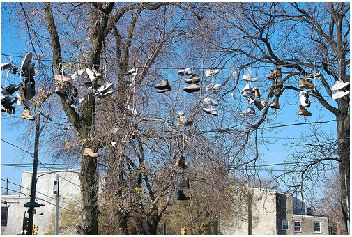 Running Shoes Hanging From Power Line