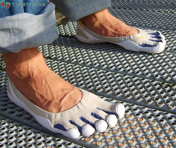 Barefoot in white Vibram Five Fingers Classic - Side View