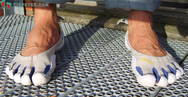 Barefoot in white Vibram Five Fingers Classic