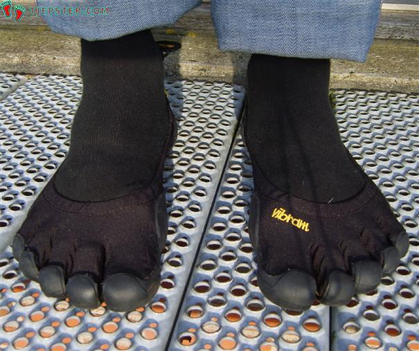 Barefoot in black Vibram Five Fingers Classic